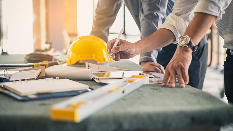 Construction engineers (bluedog studio/Shutterstock.com)