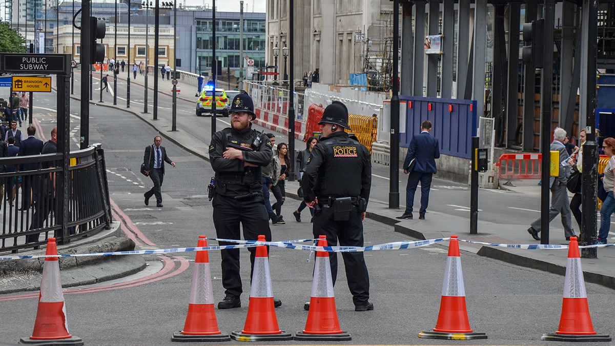 Police officers close off the approach to London Bridge following the June 3, 2017 terror attack (Adam Cowell/Shutterstock.com)